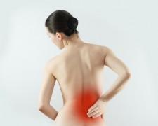 Почему болит ниже поясницы у женщин — причины и методы лечения
